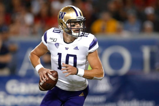 Washington quarterback Jacob Eason looks for a receiver against Arizona on Saturday, Oct. 12. UW won, 51-27.