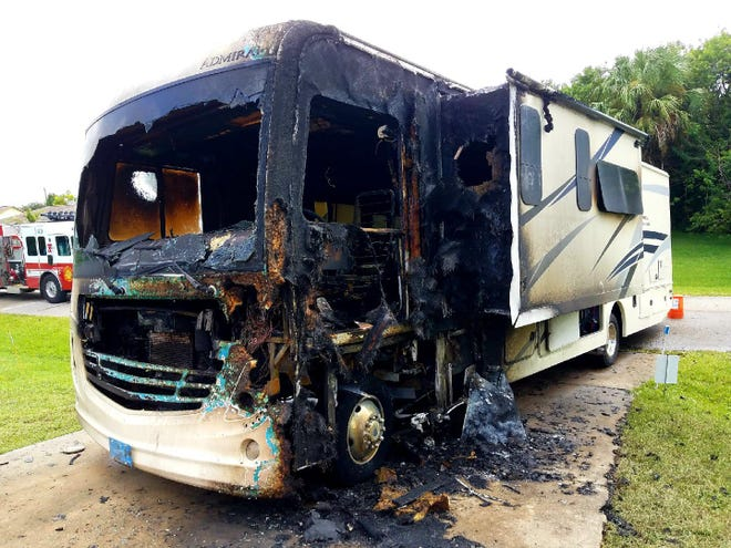 Flames tore through this recreational vehicle Friday in a Delki Street driveway in northwest Palm Bay.