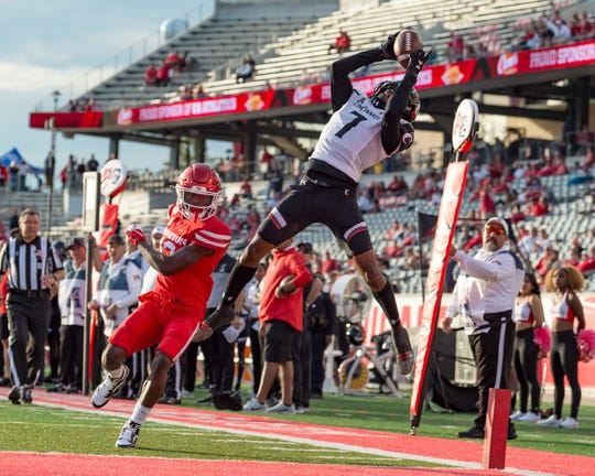 Oct 12, 2019; Houston, TX, USA;  Cincinnati Bearcats cornerback Coby Bryant (7) catches the ball in the end zone for a touch back during the fourth quarter against the Houston Cougars at TDECU Stadium. Mandatory Credit: Maria Lysaker-USA TODAY Sports