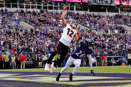 Cincinnati Bengals wide receiver Alex Erickson (12) reaches but can't come down with a pass in the end zone under pressure from Baltimore Ravens cornerback Maurice Canady (26) in the second quarter of the NFL Week 6 game between the Baltimore Ravens and the Cincinnati Bengals at M&T Bank Stadium in Baltimore on Sunday, Oct. 13, 2019.
