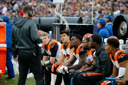 Cincinnati Bengals head coach Zac Taylor talks with the wide receivers on the bench in the fourth quarter of the NFL Week 6 game between the Baltimore Ravens and the Cincinnati Bengals at M&T Bank Stadium in Baltimore on Sunday, Oct. 13, 2019. The Bengals remained winless with a 23-17 loss to the Ravens.