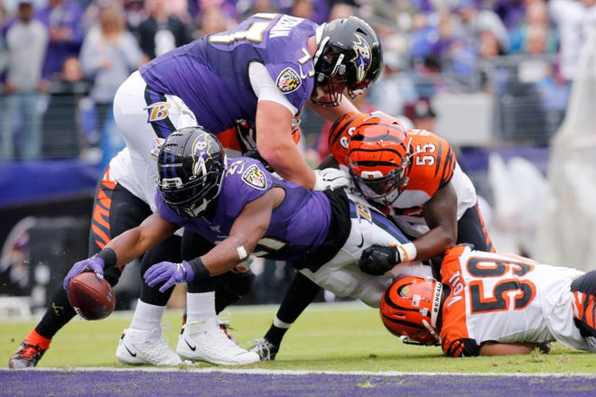 Baltimore Ravens running back Mark Ingram (21) dives into the end zone for a touchdown in the first quarter of the NFL Week 6 game between the Baltimore Ravens and the Cincinnati Bengals at M&T Bank Stadium in Baltimore on Sunday, Oct. 13, 2019.