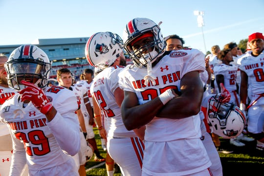 Austin Peay players strike poses in the mingle after winning an OVC football game between the Austin Peay Governors and Southeast Missouri Redhawks at Fortera Stadium in Clarksville on Saturday.