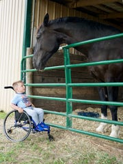Oliver Schaper, a Middle Tennessee boy diagnosed with SMA several years ago, gets up close and personal with a horse at a local stable, thanks to groundbreaking SMA treatments that have now led state health officials to add SMA to newborn screenings.