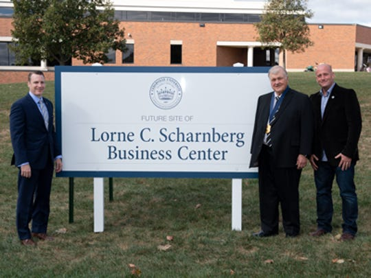 Cedarville University President Thomas White stands with Lorne Sharnberg and Mark Scharnberg where the new Lorne C. Scharnberg Business Center will stand.