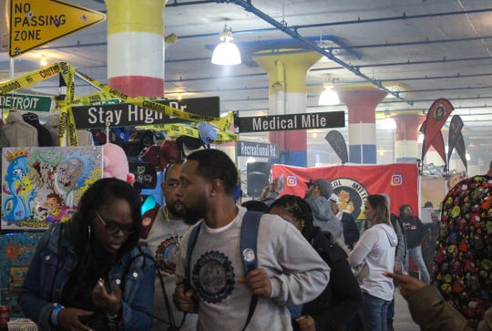 Attendees walk through indoor vendors during High Times Cannabis Bazaar at Russell Industrial Center in Detroit, Saturday, Oct. 12, 2019.