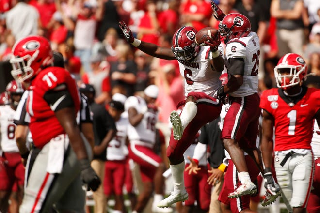 South Carolina linebacker T.J. Brunson (6) celebrates after coming up with the ball for a turnover in the second half.