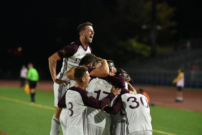 Detroit City FC players celebrate after defeated New York Cosmos B, 2-1, on Saturday Mitchel Complex in Uniondale, N.Y. The victory moved DCFC (7-0-1) into first place in the Members Cup standings with two matches remaining.