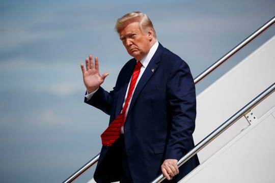 In this Sept. 26, 2019 photo, President Donald Trump waves to reporters as he steps off Air Force One after arriving at Andrews Air Force Base, in Andrews Air Force Base, Md.