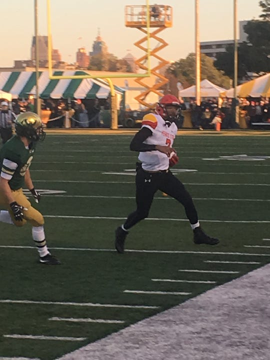 Jayru Campbell runs for some yardage during the first half.