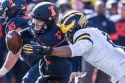 Illinois quarterback Matt Robinson is taken down by Michigan's Josh Uche in the second half.