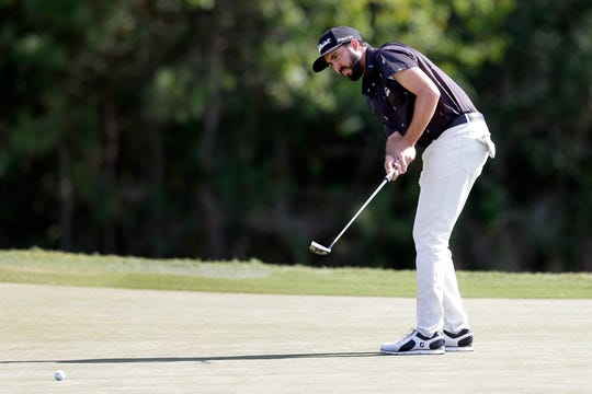 Mark Hubbard watches his putt on the eighth green during the third round of the Houston Open on Saturday.