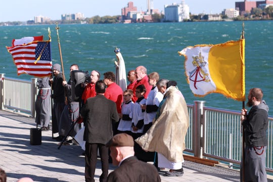 Worshippers gather along the Riverwalk to pray the Rosary  on the Riverwalk, in Detroit, Oct. 13, 2019.  A similar event occurred across the river at the Bert Weeks Memorial Gardens in Windsor as part of the second annual Rosary Coast to Coast, a series of Rosary prayer rallies happening simultaneously across the planet.
