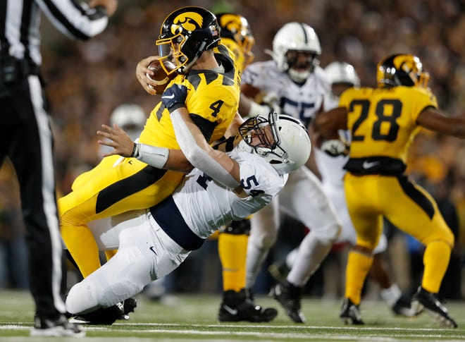Penn State defensive tackle Robert Windsor, center, sacks Iowa quarterback Nate Stanley during the second half on Saturday.