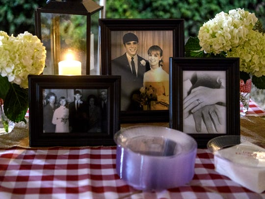 Pictures from Larry and Ethelda Ryan's wedding decorate a table where cake and snacks are served during the couple's 50th wedding anniversary party at Evansville's Bosse Field, Saturday evening, Oct. 12, 2019. The couple got married on Nov. 28, 1969, when Larry was 17 and Ethelda was 16.