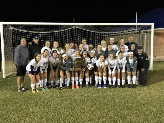 The Castle girls' soccer team poses with the sectional championship trophy after beating North 6-0 in the final.