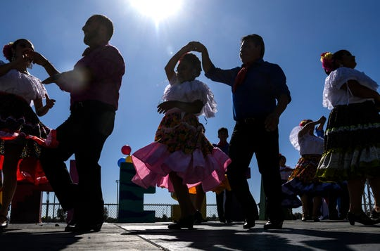 Members of the Ballet Folklorico Mosaicos, a Mexican dance group from Indianapolis, perform during the 6th annual Fiesta Evansville event held at Wesselman Park, Sunday afternoon, Oct. 13, 2019. The event celebrated Latin American culture through food, live music and dancing from 11 a.m. to 6 p.m.