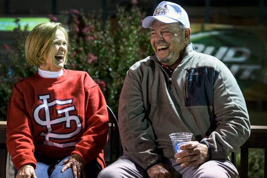 Ethelda, left, and Larry Ryan laugh as they listen to a toast given by Dwight Owen, who has been a friend of Larry's since childhood, during their 50th wedding anniversary celebration at Evansville's Bosse Field, Saturday evening, Oct. 12, 2019. Larry was an all-city third baseman for Bosse High School who noticed Ethleda, a Harrison High School student, sitting near the third-base dugout during a game in their junior year.