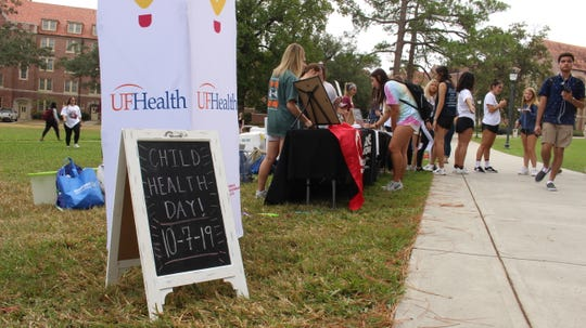 Students register to dance during the Child Health Day event Dance Marathon held last Monday on Landis Green.