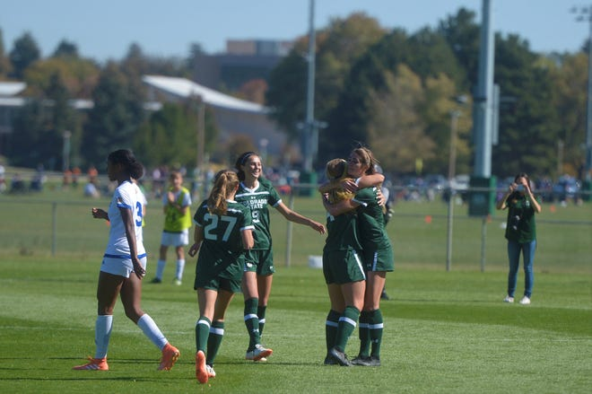 Colorado State soccer players hug Taylor Steinke, furthest right, after her goal during a game against San Jose State on Sunday, Oct. 13, 2019. The Rams won 2-1.