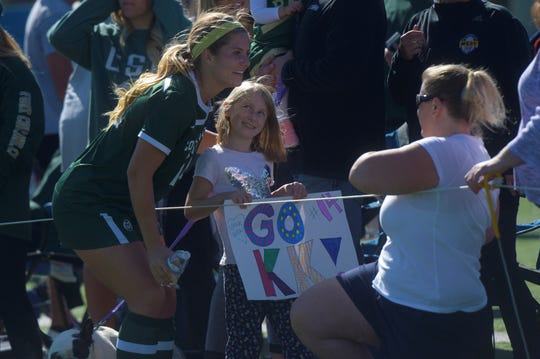 Colorado State soccer player Caeley Lordemann takes a picture with a fan after a game against San Jose State on Sunday, Oct. 13, 2019. The Rams won 2-1.
