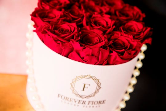 Elsewhere in Royal Palm Square, Forever Fiore also has a flower shop selling hatbox arrangements of traditional and preserved flowers.