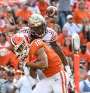 Florida State defensive back Renardo Green(36) and Clemson wide receiver T.J. Chase (18) look at a loose ballduring the third quarter at Memorial Stadium in Clemson, South Carolina Saturday, October 12, 2019. Green was called for pass interference.