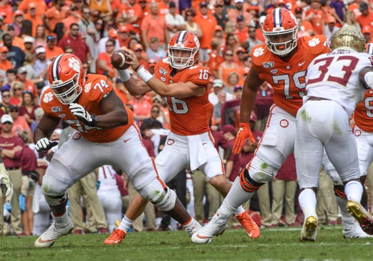 Clemson offensive guard John Simpson (74),left, and offensive lineman Jackson Carman (79) block for quarterback Trevor Lawrence (16) during the second quarter at Memorial Stadium in Clemson, South Carolina Saturday, October 12, 2019.
