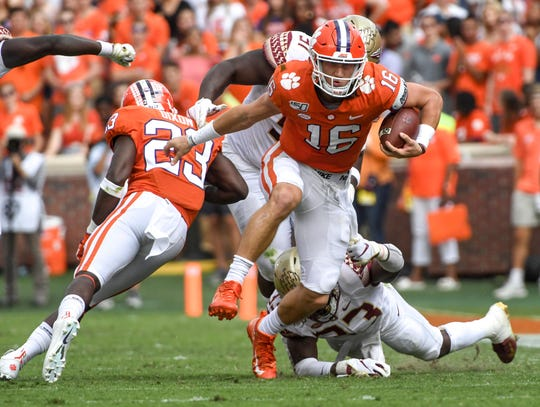 Clemson quarterback Trevor Lawrence (16) runs with the ball against Florida State during the second quarter at Memorial Stadium in Clemson, South Carolina Saturday, October 12, 2019.