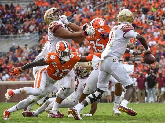 Clemson defensive back K'Von Wallace (12) pressures Florida State quarterback James Blackman(1) during the third quarter at Memorial Stadium in Clemson, South Carolina Saturday, October 12, 2019.