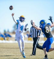 CJI's Kyle Harmon throws downfield during Saturday's football game against Great Falls Central.