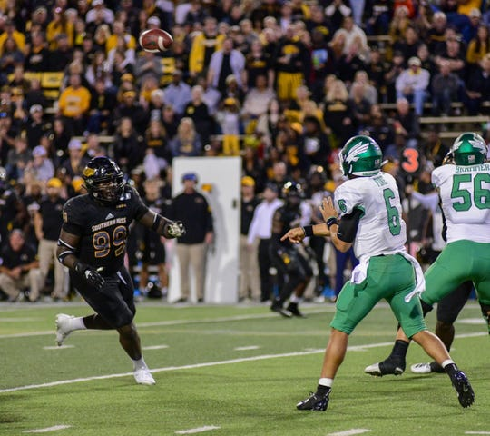North Texas quarterback Mason Fine (6)throws a pass during the first half against Southern Miss Oct. 12, 2019.