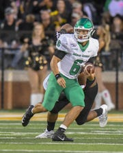 North Texas quarterback Mason Fine makes a run against Southern Miss Saturday, Oct. 12, 2019.