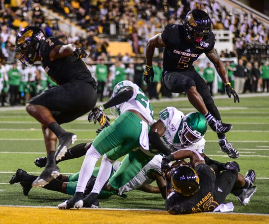 Southern Miss wide receiver De'Michael (18) scores a touchdown against North Texas Saturday, Oct. 12, 2019.