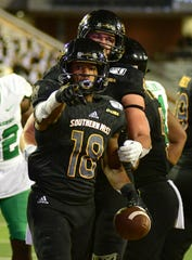 Southern Miss wide receiver De'Michael Harris (18) celebrates after scoring a touchdown against North Texas Saturday, Oct. 12, 2019.