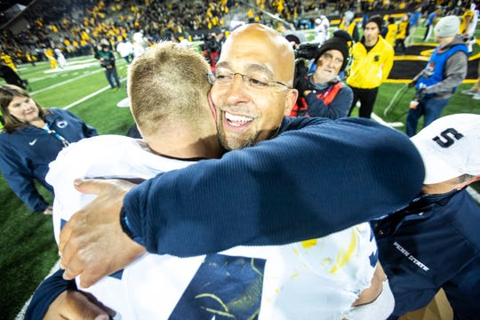 Penn State head coach James Franklin embraces defensive tackle Robert WIndsor (54) after a NCAA Big Ten Conference football game between the Iowa Hawkeyes and Penn State, Saturday, Oct., 12, 2019, at Kinnick Stadium in Iowa City, Iowa.