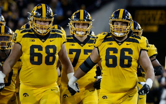 Landan Paulsen (68) remains the Hawkeyes' starting left guard, while twin brother Levi (66) has been on the bench since starting the Hawkeyes' first four games (one at right guard, three at right tackle).