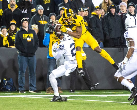 Iowa wide receiver Brandon Smith (12) pulls in a rolling touchdown pass in the second half during a NCAA Big Ten Conference football game between the Iowa Hawkeyes and Penn State, Saturday, Oct., 12, 2019, at Kinnick Stadium in Iowa City, Iowa.