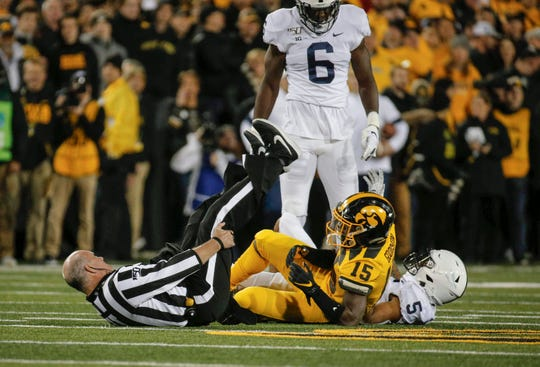 Umpire Jeff Carr collides with Iowa running back, Tyler Goodson during a play against Penn State on Saturday, Oct. 12, 2019, at Kinnick Stadium in Iowa City.