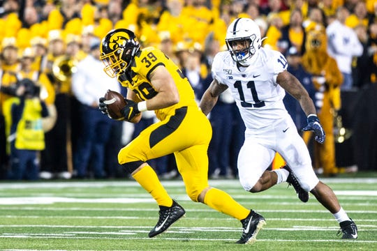 Iowa tight end Nate Wieting (39) pulls in a pass as Penn State linebacker Micah Parsons (11) defends during a NCAA Big Ten Conference football game between the Iowa Hawkeyes and Penn State, Saturday, Oct., 12, 2019, at Kinnick Stadium in Iowa City, Iowa.