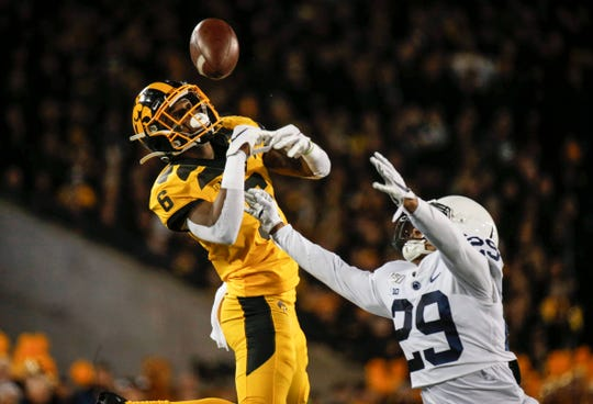 Iowa receiver Ihmir Smith-Marsette is unable to pull down a catch against Penn State on Saturday, Oct. 12, 2019, at Kinnick Stadium in Iowa City.