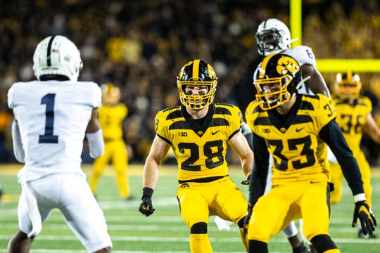 Iowa defensive back Jack Koerner (28) and Iowa defensive back Riley Moss (33) defend a punt return during a NCAA Big Ten Conference football game between the Iowa Hawkeyes and Penn State, Saturday, Oct., 12, 2019, at Kinnick Stadium in Iowa City, Iowa.