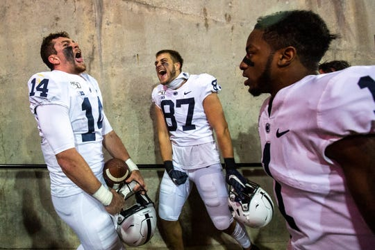 Penn State quarterback Sean Clifford (14) celebrates with teammates K.J. Hamler (1) and Pat Freiermuth (87) after a NCAA Big Ten Conference football game between the Iowa Hawkeyes and Penn State, Saturday, Oct., 12, 2019, at Kinnick Stadium in Iowa City, Iowa.