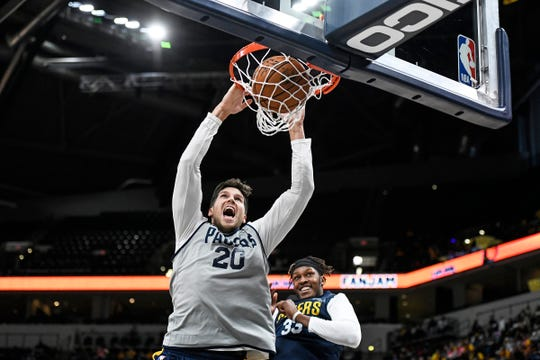 Indiana Pacers forward Doug McDermott (20) dunks over Indiana Pacers center Myles Turner (33) during Pacers FanJam on Sunday, Oct. 13, 2019 at Bankers Life Fieldhouse. The family fun event is held to kick off the 2019-2020 season and features a scrimmage between the Pacers team.