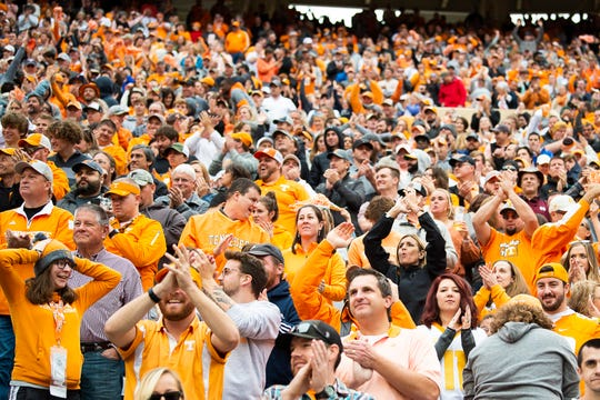 Tennessee fans cheer after running back Tim Jordan scored a touchdown during the first quarter at Neyland Stadium in Knoxville during the Volunteers' SEC matchup against Mississippi State on Saturday, Oct. 12, 2019.