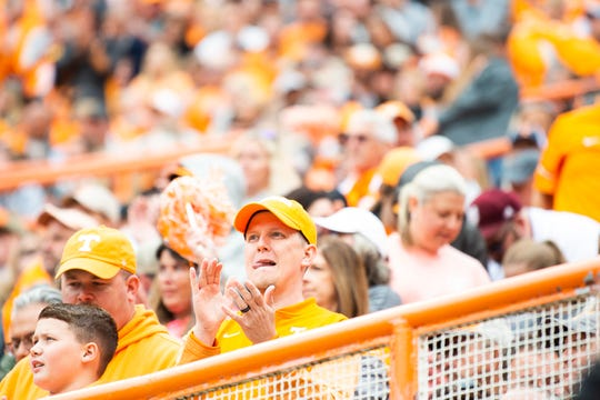 A Tennessee fan cheers after kicker Brent Cimaglia (42) kicks a field goal in the third quarter to extend the Volunteers' lead in an SEC matchup against Mississippi State at Neyland Stadium in Knoxville on Saturday, Oct. 12, 2019.