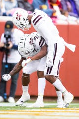 Mississippi State wide receiver Deddrick Thomas (2) celebrates his touchdown catch with fellow receiver Stephen Guidry (1) in the fourth quarter of the Bulldogs' SEC matchup against Tennesseee at Neyland Stadium in Knoxville on Saturday, Oct. 12, 2019.