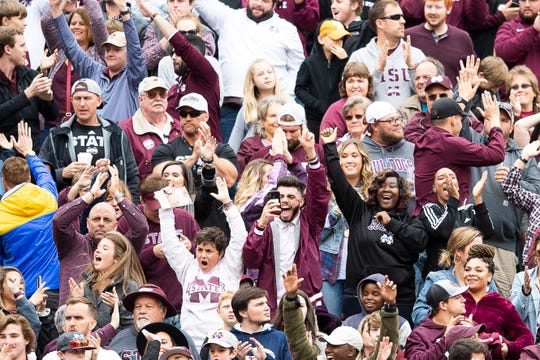Mississippi State fans cheer after wide receiver Deddrick Thomas (2) caught a touchdown pass in the fourth quarter of the Bulldogs' SEC matchup against Tennesseee at Neyland Stadium in Knoxville on Saturday, Oct. 12, 2019.