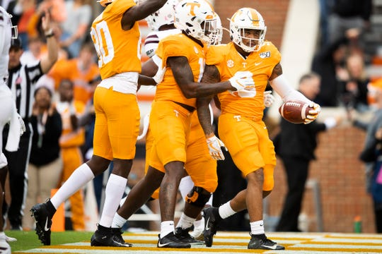 Tennessee running back Tim Jordan (9) celebrates with teammates after he opened the scoring with a touchdown during the first quarter at Neyland Stadium in Knoxville during the Volunteers' SEC matchup against Mississippi State on Saturday, Oct. 12, 2019.