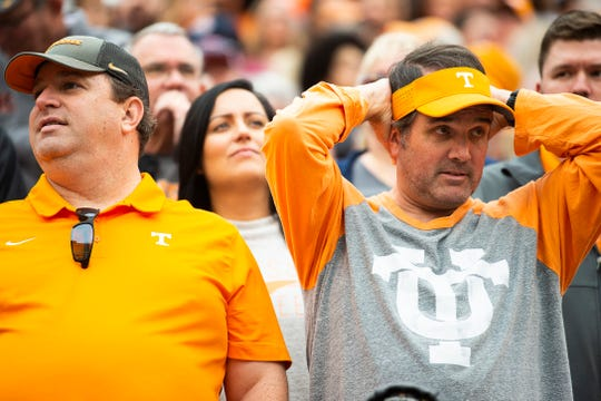 A Tennessee fan cringes after Mississippi State kicked a field goal during the second quarter at Neyland Stadium in Knoxville during the Volunteers' SEC matchup against Mississippi State on Saturday, Oct. 12, 2019.
